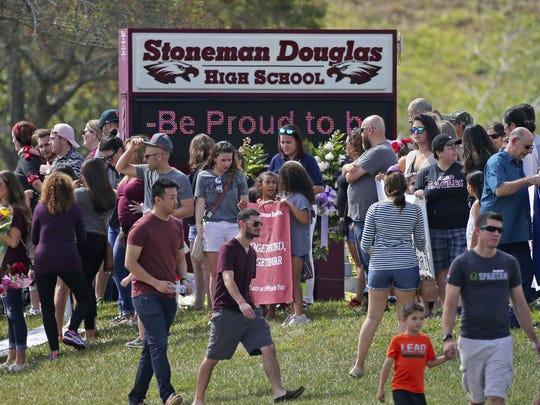 Parents and students arrive at Marjory Stoneman Douglas