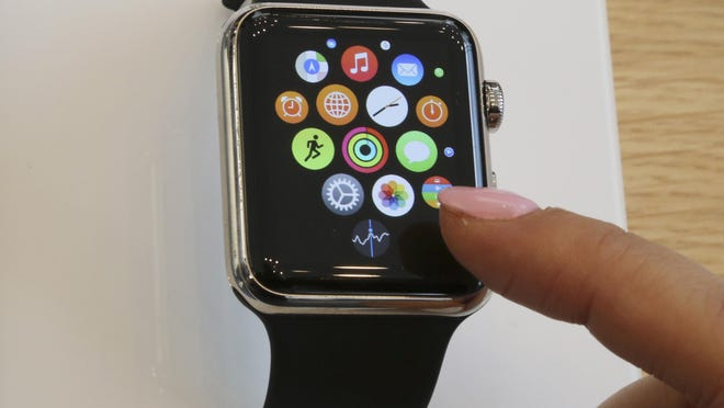 A customer checks out an Apple Watch after the product's launch in 2015.