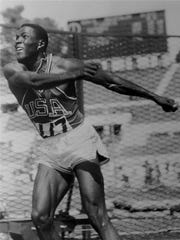 Rafer Johnson of Kingsburg, throws the discus in the decathlon event at the Olympics in Rome, Sept. 6, 1960.