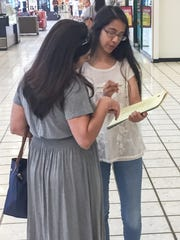 Sofia Del Toro, right, a senior at Coronado High School, interviewed a voter at Bassett Place Saturday as part of an exit poll project.