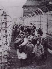 Holocaust survivor Eva Kor (front middle) and her sister,