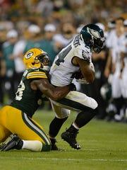 Green Bay Packers linebacker Sam Barrington (58) tries