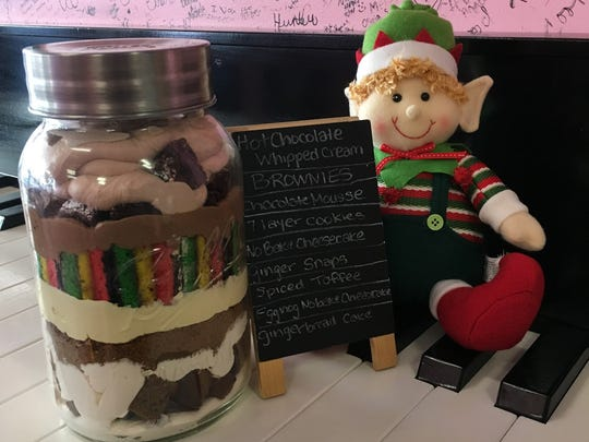 The Jingle Jar from Confections of a Rock$tar in Asbury Park is layers of gingerbread cake, no-bake cheesecake, gingersnap crumble, no-bake eggnog cheesecake, spicy toffee drizzle, rainbow cookies, chocolate mousse, brownies and hot chocolate whipped cream.