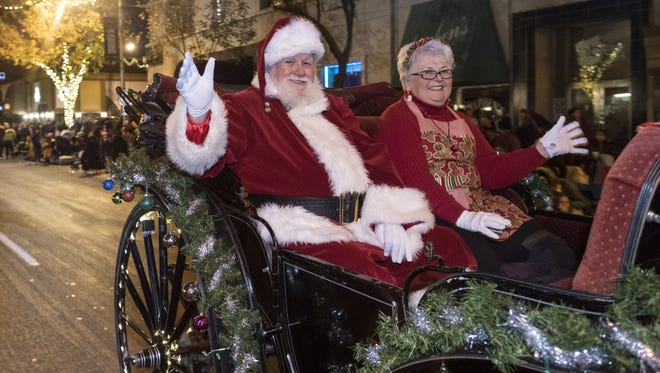 Santa and Mrs, Claus bring up the rear of the 71st Annual Candy Cane Lane Parade in Downtown Visalia on Monday, November 28, 2016.