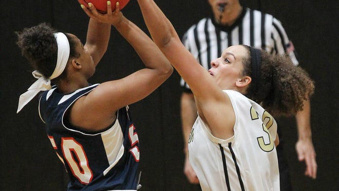 Anderson junior forward Kaylee Koerperich, right, blocks the shot of Catawba forward Alexis Newbold during the second quarter on Saturday at Anderson University.