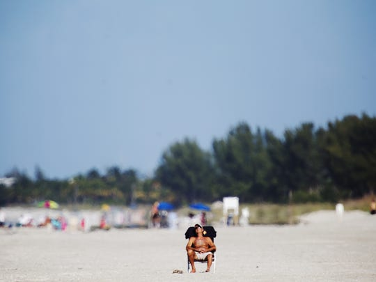 A beachgoer takes in the rays on a renourished part of Captiva Beach in this 2014 file photo. The project added 750,000 cubic yards of sand onto Captiva's beach from Redfish Pass to Blind Pass and 75,000 cubic yards more to Sanibel's shoreline, starting at Blind Pass.