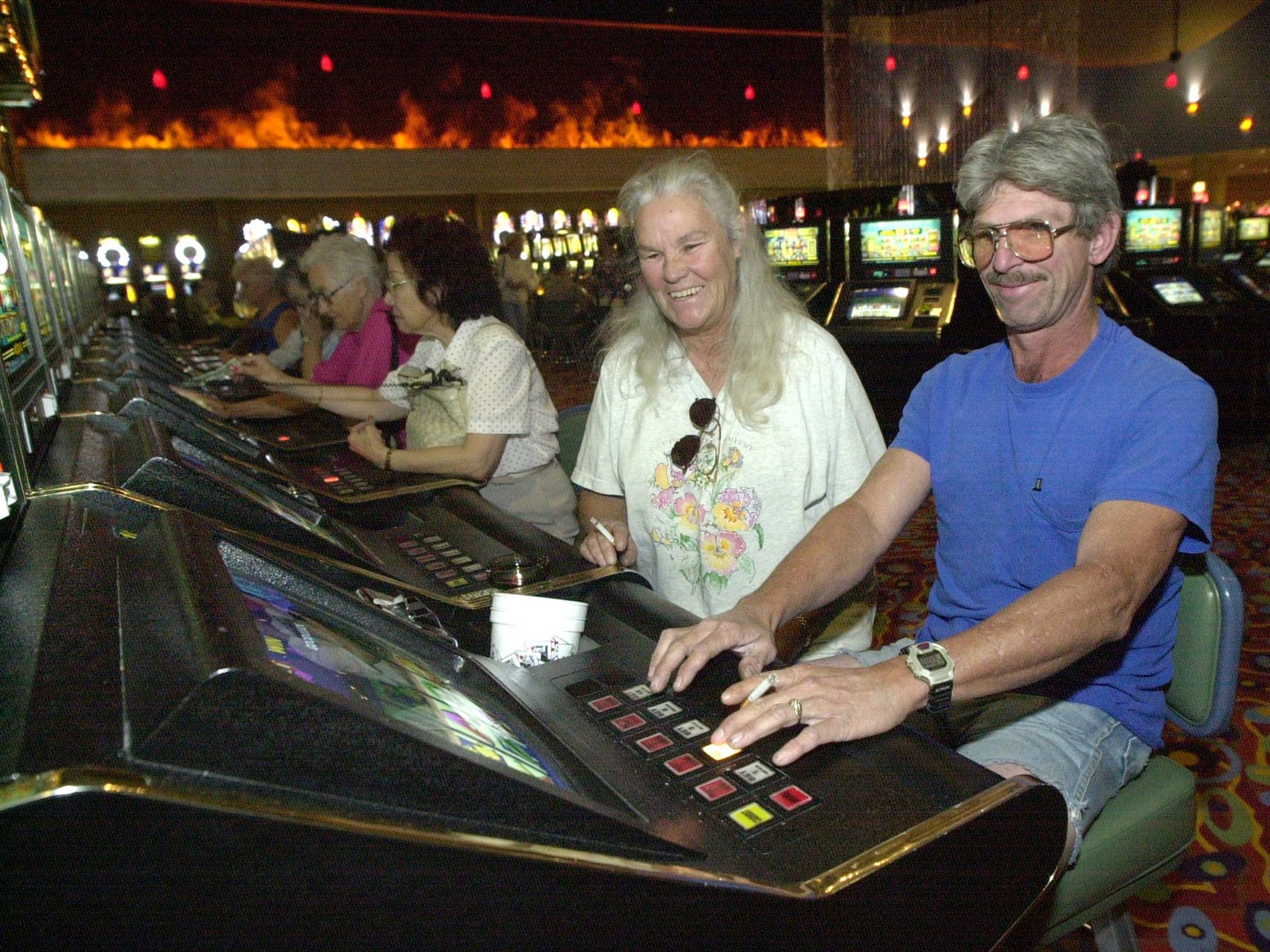 Mary and Jim Spivey of Florida try their luck on the slot machines at Trump 29 Casino in Coachella.