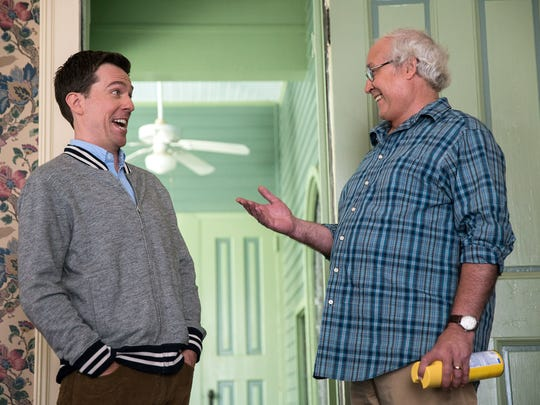 """In this image released by Warner Bros. Entertainment, Ed Helms, left, and Chevy Chase appear in a scene from """"Vacation."""""""