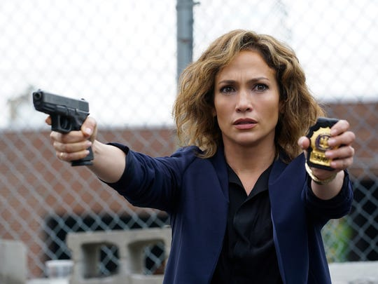 Jennifer Lopez dons a badge as Detective Harlee Santos in cop drama 'Shades of Blue.'