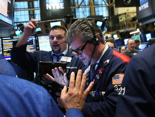 Stocks fall as oil resumes slide, Fed rate decision looms