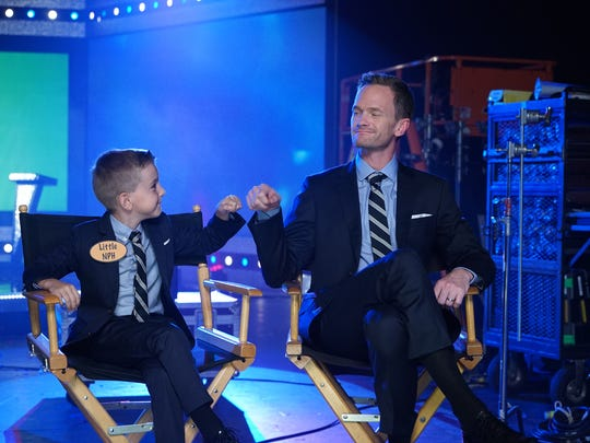 "In this image released by NBC shows Nathaniel Motulsky as Little NPH, left, and Neil Patrick Harris during a promotion for ""Best Time Ever with Neil Patrick Harris,"" premiering Sept. 15 on NBC. (Chris Haston/NBC via AP)"
