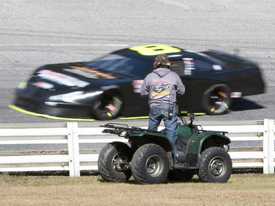 NASCAR veteran driver Joe Nemecheck watches as his son John Hunter Nemecheck races around the track while testing at Five Flags Speedway in Pensacola on Tuesday, November 22, 2016.  Teams are getting ready for the annual Snowball Derby.