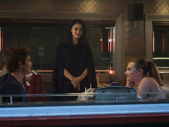 """Archie (KJ Apa, from left), Veronica (Camila Mendes) and Betty (Lili Reinhart) square off in """"Riverdale."""""""