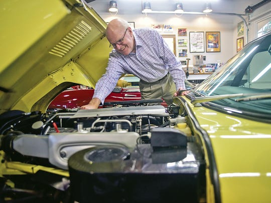 """In this June 7, 2017 photograph, Eddie Mauck shows the powerful V-12 engine of his '72 Jaguar XKE. The Aston Martin and both of Mauck's Jaguars hold V12s. His British and German engineered cars are in his Columbus, Miss., garage. """"I've loved cars from the beginning of my memory,"""" Mauck says."""