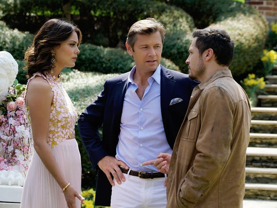 "This image released by The CW shows, from left, Nathalie Kelley, Grant Show and Nick Wechsler in a scene from ""Dynasty,"" premiering Oct. 11 on The CW."
