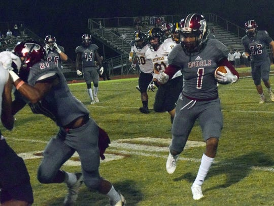 Pineville's Troy Hall (1, right) gains yards against Leesville High School during a 2017 game.