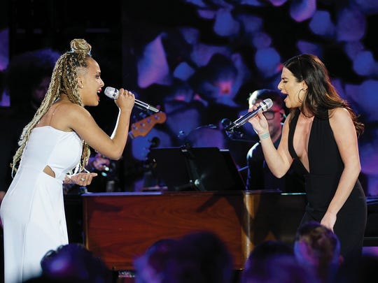 """Lea Michele performs with finalist Jurnee during the all-star duets in season 16 of """"American Idol."""""""