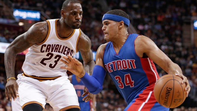 Pistons' forward Tobias Harris (34) drives past Cavaliers forward LeBron James (23) in the second half of the Pistons' 96-88 win Monday in Cleveland.