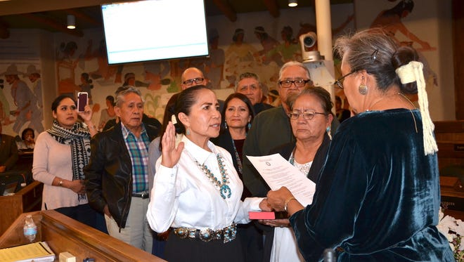 JoAnn B. Jayne, center, receives the oath of office as the probationary chief justice for the Navajo Nation Supreme Court on Wednesday in Window Rock, Ariz.