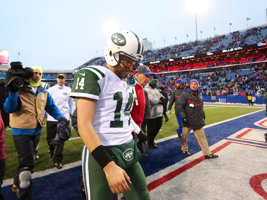 New York Jets quarterback Ryan Fitzpatrick (14) leaves the field after an NFL football game against the Buffalo Bills Sunday, Jan. 3, 2016, in Orchard Park, N.Y. The Bills won 22-17. (AP Photo/Bill Wippert)