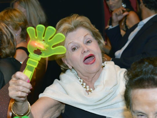 Audience member Nora Pulido had her glow hand clapper
