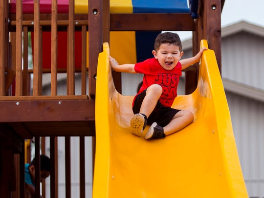 Jayson Rodriguez, 4, plays in the play area at the