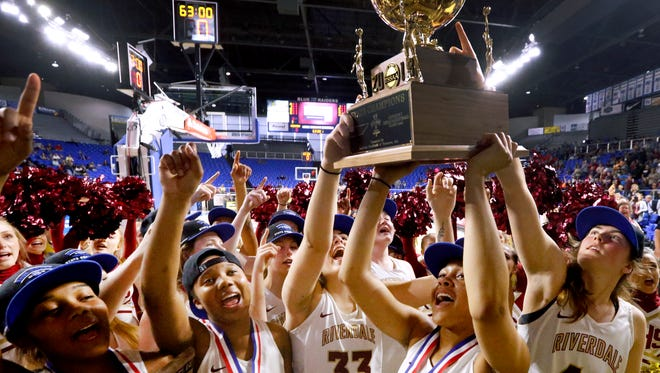 Riverdale's players (L to R) Aislynn Hayes, Alasia Hayes, Alli Mayeux, Brinae Alexander and Brylee Puckett all sing the Riverdale Alma Mater as they show off their Div. 1 Class AAA State Championship Trophy to the fans after beating Houston in TSSAA Girls State Basketball Tournament on Saturday, March 10, 2018, at MTSU.