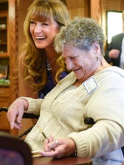 Jane Seymour smiles while talking with seniors during an art class at St. Benedict's Senior Community Friday, May 5, in St. Cloud.