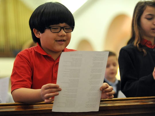 Bishop Schad Regional School third grade student Christian Bernabe, 8, of Vineland, sings during a prayer service honoring school principal Dr. Patrice DeMartino at Sacred Heart Church, Tuesday, Feb. 2 in Vineland.