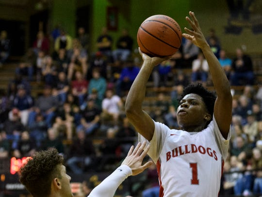 Bosse's Jaylin Chinn (1) makes a shot during the IHSAA Class 3A semistates against the Danville.