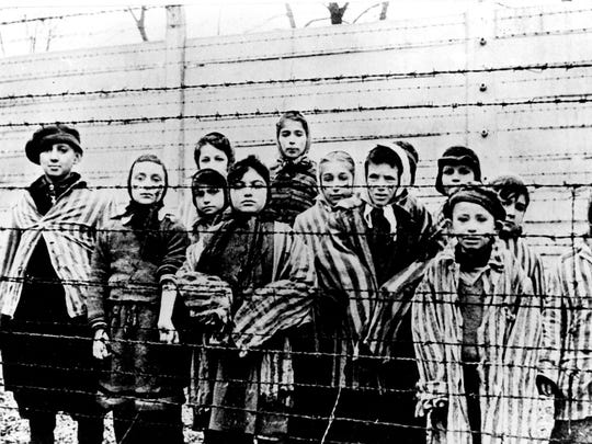 Children imprisoned at the infamous Nazi death camp Auschwitz in Poland shortly after liberation in January 1945.