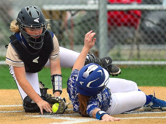 Susquehanna Valley catcher Emily DeMoney (33)) attempts to stop Horseheads Emma Loomis (20) during Horseheads Blue Raiders vs. Susquehanna Valley Sabers, Southern Tier Athletic Conference softball final at Chenango Valley High School, May 16, 2018.