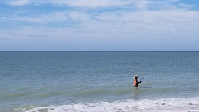 Alex Drozdetski fishes off the sands of Barefoot Beach County Preserve. The Bonita Springs resident is a regular visitor and uses the $50 Collier County beach parking pass to avoid paying $8 every visit, although he will not be able to renew the pass once it expires.