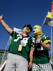 """Scott Schwartz, of Pulaski, Wis., and Justin Sipla, of Iowa City, sing """"Tim, the Die-Hard Packer Fan"""" from their tailgate before the Green Bay Packers' game against the St. Louis Rams.The Green Bay Packers host the St. Louis Rams Sunday, Oct. 11, 2015, at Lambeau Field in Green Bay, Wis."""