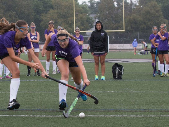 Katie MacGillis and Lily Croddick battle for ball during