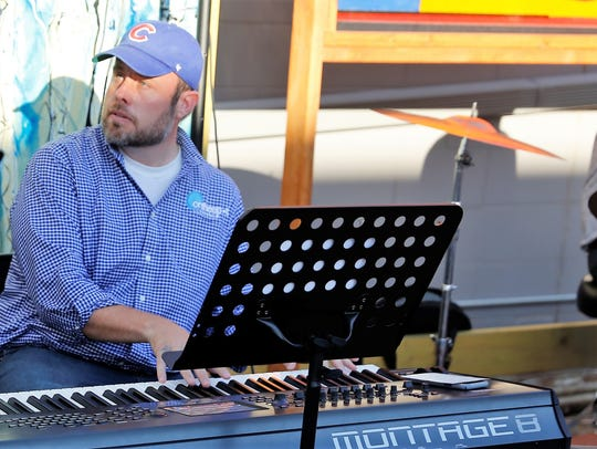 Keyboard player Sheldon Pickering is part of the band performing at the first weekly jazz jam session in the Studio 116 pocket park on July 11.