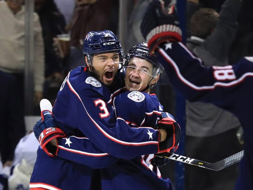 Columbus Blue Jackets defenseman Seth Jones, left, celebrates the goal scored by center Alexandre Texier, right, against the Tampa Bay Lightning in the first period during game four of the first round of the 2019 Stanley Cup Playoffs at Nationwide Arena in Columbus, Ohio. AARON DOSTER, USA TODAY Sports