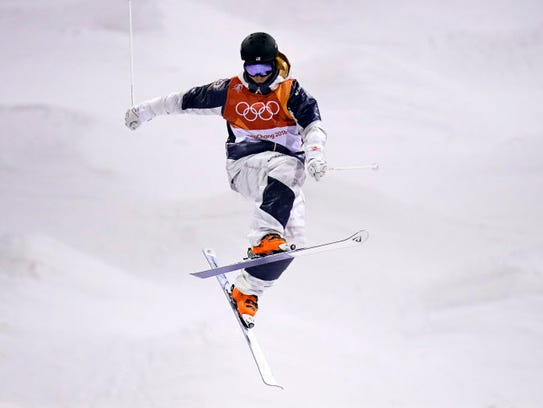Casey Andringa flies over some moguls during a training