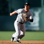 New York Yankees first baseman Rob Refsnyder breaks to cover first base to field a throw on ground ball hit by Colorado Rockies' DJ Lemahieu in the first inning of a baseball game Tuesday, June 14, 2016, in Denver.