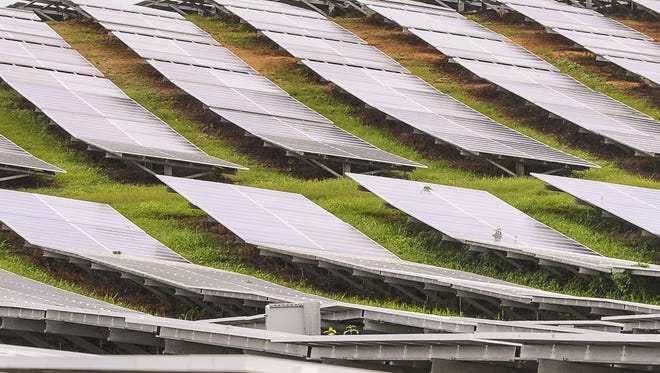 Rows of photo voltaic panels at nrg Renew's Dandan Solar Facility are shown in this file photo.