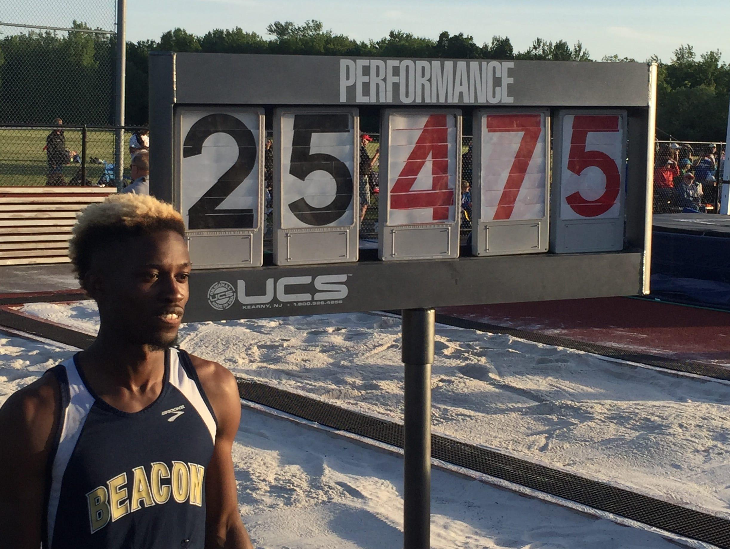 Beacon's Rayvon Grey sets NY State long jump record.