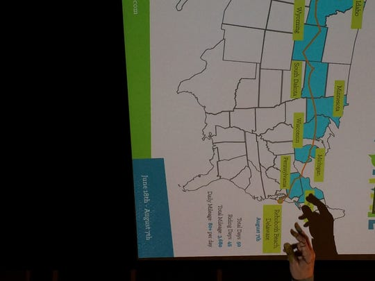Markell points to the map charting his route across the country, from Oregon to Rehoboth Beach.