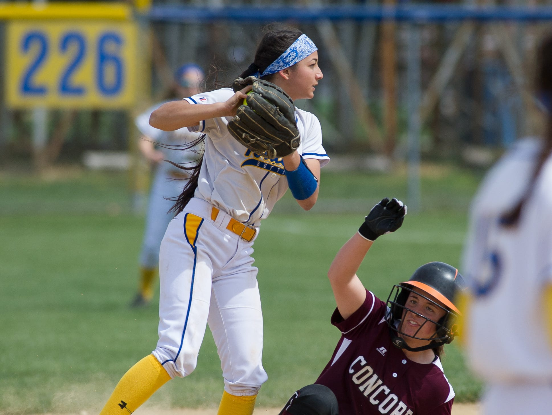 Caesar Rodney's Kendall Lewis (2) tags out Concord's Eryn Bailey (8) at second base.