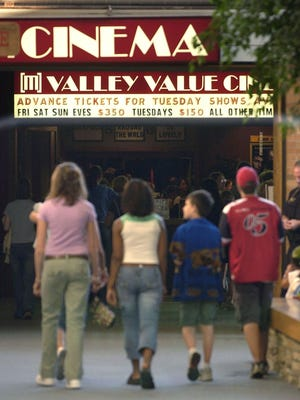 A group of young people head to Valley Value Cinema located in Valley Fair Mall in this file shot from 2004. The theater became a freestanding building in 2007 when the mall was torn down.