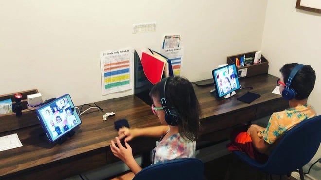 This is the virtual school setup Amanda Sorena set up for her twins.