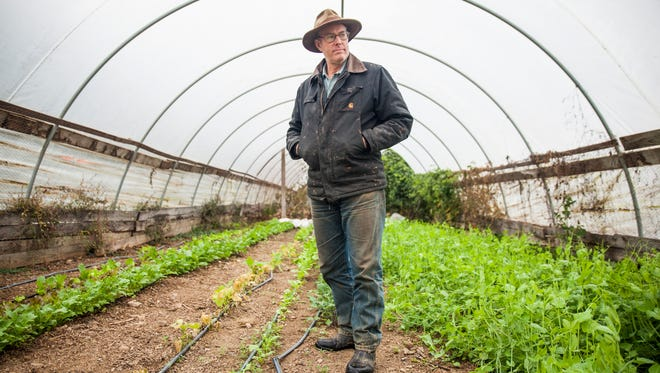 Joel Salatin stands inside a hoop house at Polyface Farms on Wednesday, Oct. 28, 2015.