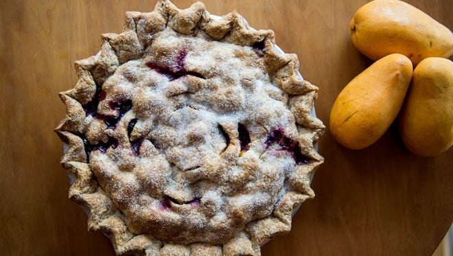 True Confections in the Grove Arcade offers a fresh blueberry and mango pie.