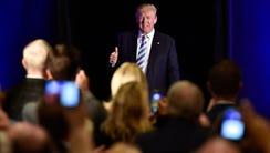 GOP presidential nominee Donald Trump walks on stage