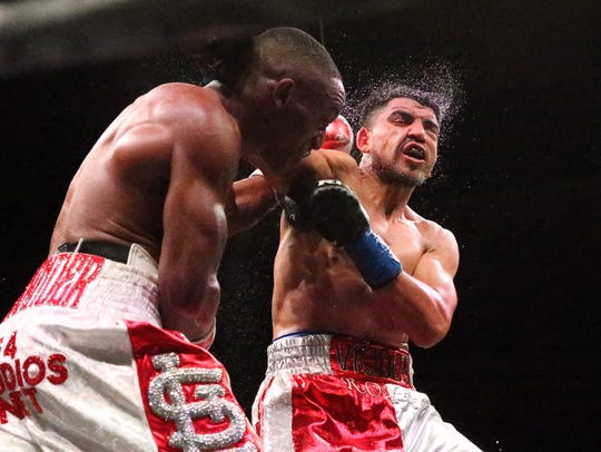 Devon Alexander, left, lands a punch to the face of