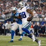 Dallas Cowboys wide receiver Dez Bryant (88) carries the ball after a catch chased by Detroit Lions defensive end Jason Jones (91) during the first quarter in the NFC Wild Card Playoff Game at AT&T Stadium.